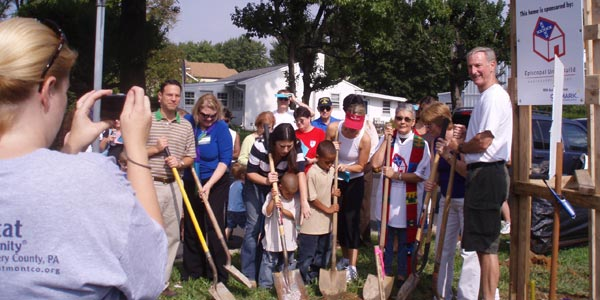 Volunteers break ground, commencing the Episcopal Unity Build. (2008)