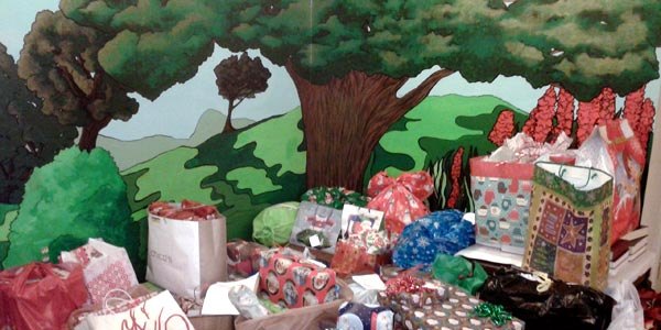 Donations and gifts await pickup by the Chapel mural for Carson Valley.